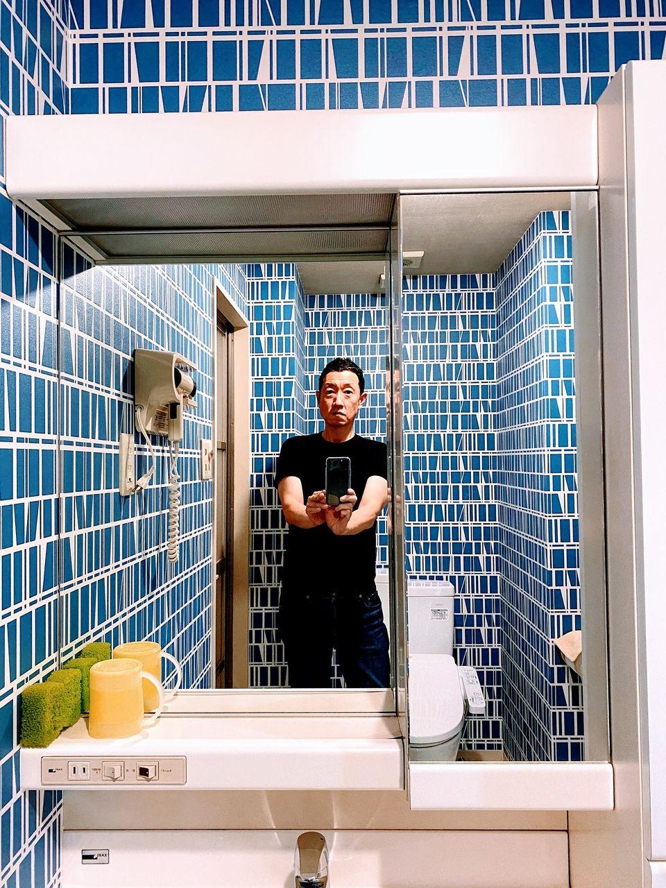 新潟県南魚沼市のツインタワー石打の洗面所のリフォーム・テレビのインチアップ